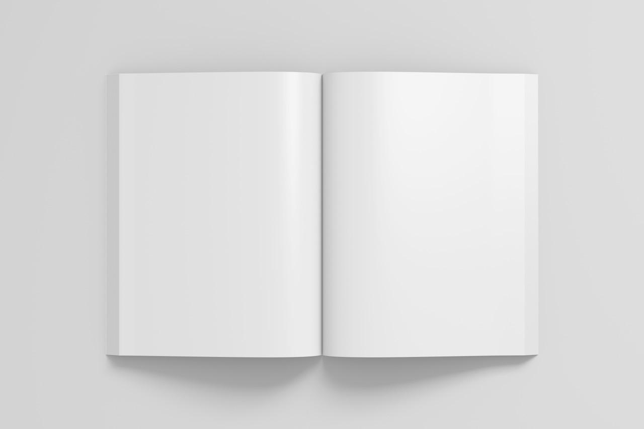 Blank pages of open portrait soft cover book with glossy paper. Isolated  on white background with clipping path around book. 3d illustration.